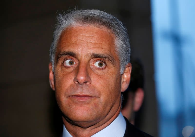 FILE PHOTO: Andrea Orcel, the head of the UBS investment bank, arrives to give evidence to the UK Parliamentary banking inquiry on Libor interest rates in London