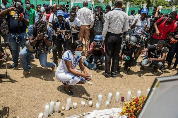 PHOTO: A person places a candle at a makeshift memorial outside of the Presidential Palace in Port-au-Prince on July 14, 2021, in the wake of Haitian President Jovenel Moise's assassination on July 7. (Valerie Baeriswyl/AFP via Getty Images)