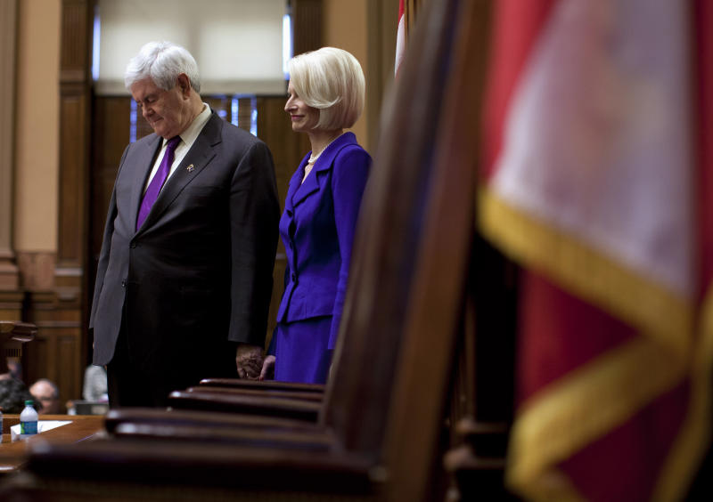 Republican presidential candidate, former House Speaker Newt Gingrich, and his wife Callista, are introduced on the floor of the Georgia House Chamber in Atlanta, Wednesday, Feb. 29, 2012. (AP Photo/Evan Vucci)