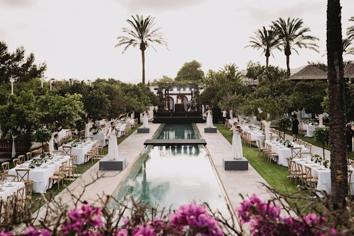 After cocktails, the guests walked down to see this view: The beautiful orange tree garden at Atzaro where the gorgeous violinists were playing. What a vision!