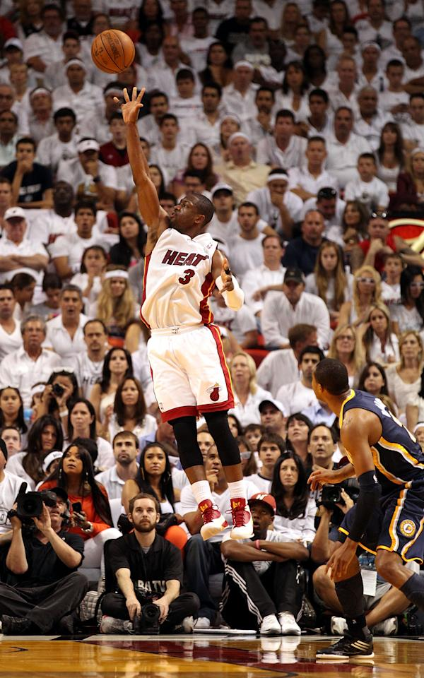 MIAMI, FL - MAY 13:  Guard Dwyane Wade #3 of the Miami Heat shoots against the Indiana Pacers in Game One of the Eastern Conference Semifinals in the 2012 NBA Playoffs on May 13, 2012 at the American Airines Arena in Miami, Florida. The Heat defeated the Pacers 95-86. NOTE TO USER: User expressly acknowledges and agrees that, by downloading and or using this photograph, User is consenting to the terms and conditions of the Getty Images License Agreement.  (Photo by Marc Serota/Getty Images)