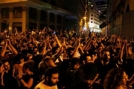 People gesture during a protest over deteriorating economic situation in Beirut