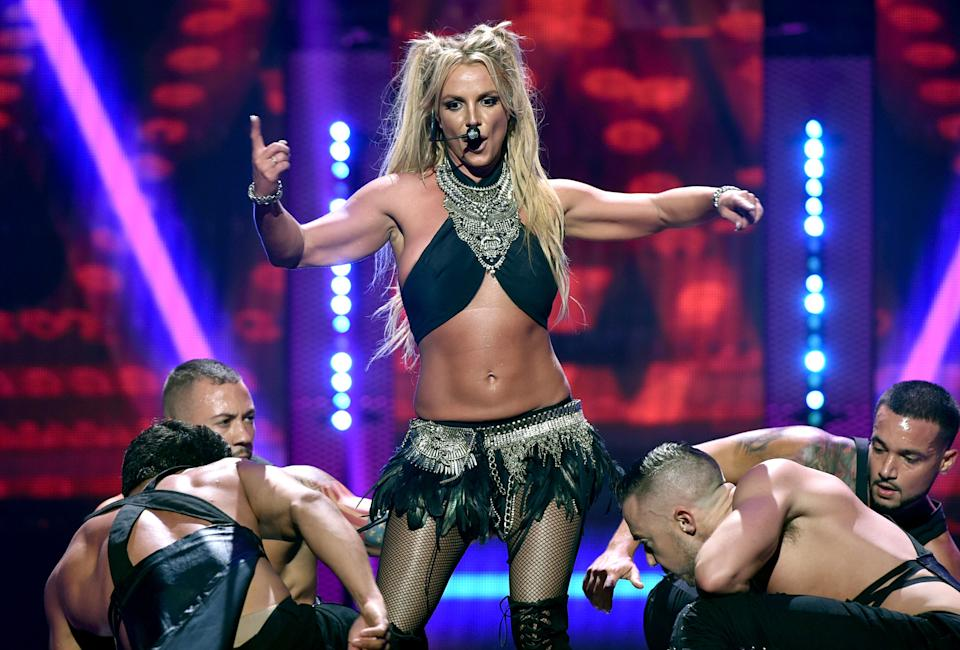 LAS VEGAS, NV - SEPTEMBER 24:  Recording artist Britney Spears (C) performs onstage at the 2016 iHeartRadio Music Festival at T-Mobile Arena on September 24, 2016 in Las Vegas, Nevada.  (Photo by John Shearer/Getty Images for iHeartMedia)