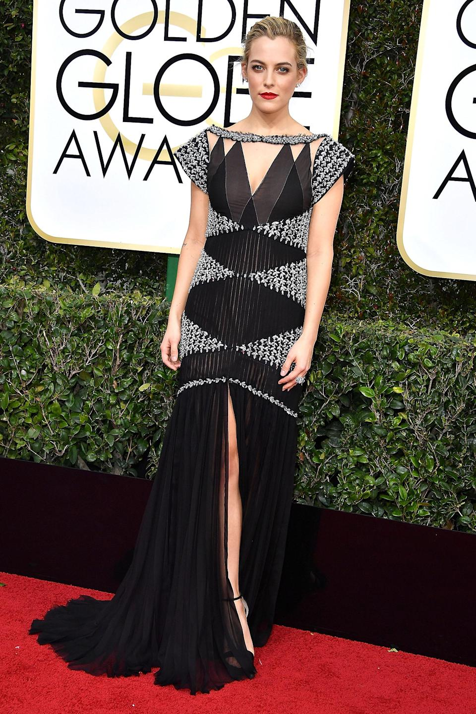 """<strong><h2>2017</h2></strong><br>Draped in Chanel Couture, Riley Keough might have been new to the Golden Globes in 2017, but she looked anything <em>but</em> out of place on the red carpet.<br><br><em>Riley Keough in Chanel Couture.</em><span class=""""copyright"""">Photo: Steve Granitz/WireImage.</span>"""