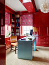 """<p>One way to ensure your office isn't a total snooze? Paint on a few coats of high-gloss paint in a bright shade. """"The raspberry shade is exciting but not overwhelming—it's the perfect hue for a creative space,"""" says Katie Ridder of this study she designed for a Manhattan client. </p>"""