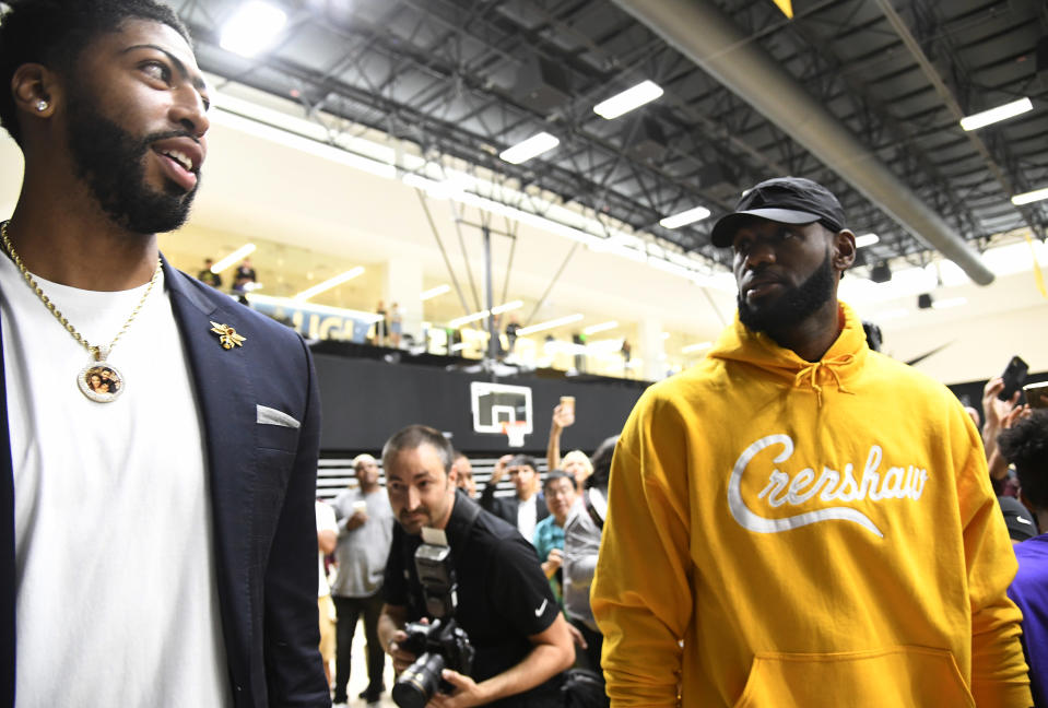 EL SEGUNDO, CA - JULY 13: LeBron James (R) talks with Anthony Davis after during a press conference where Davis was introduced as the newest player of the Los Angeles Lakers at UCLA Health Training Center on July 13, 2019 in El Segundo, California. NOTE TO USER: User expressly acknowledges and agrees that, by downloading and/or using this Photograph, user is consenting to the terms and conditions of the Getty Images License Agreement. (Photo by Kevork Djansezian/Getty Images)