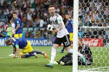 Soccer Football - World Cup - Group F - Germany vs Sweden - Fisht Stadium, Sochi, Russia - June 23, 2018 Germany's Marco Reus celebrates scoring their first goal as Sweden's Andreas Granqvist and Robin Olsen look dejected REUTERS/Francois Lenoir