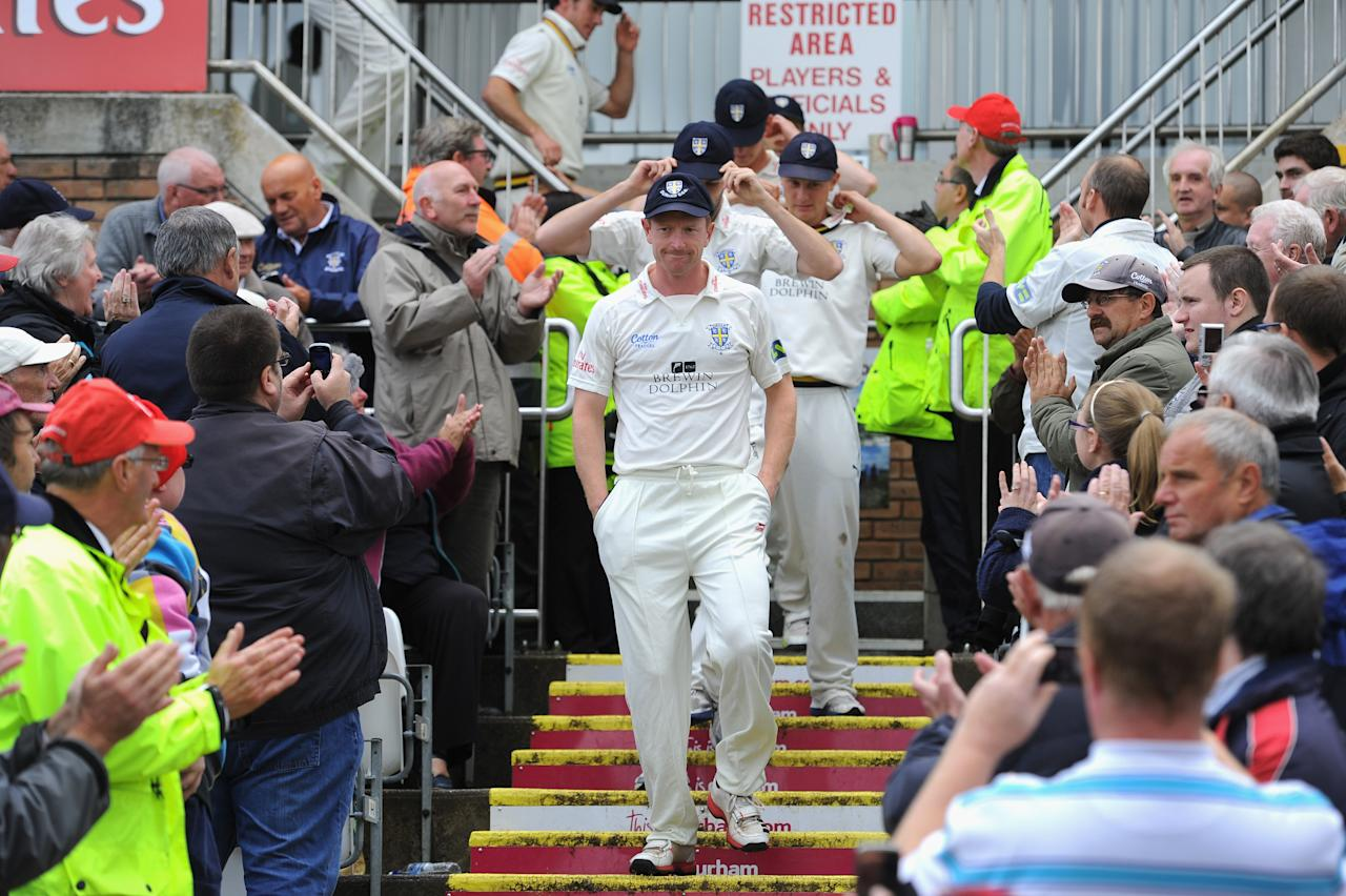 CHESTER-LE-STREET, ENGLAND - SEPTEMBER 19:  Durham captain Paul Collingwood leads his team onto the pitch after winning the LV County Championship Division One title after day three of the LV County Championship Division One match between Durham and Nottinghamshire at The Riverside on September 19, 2013 in Chester-le-Street, England.  (Photo by Stu Forster/Getty Images)