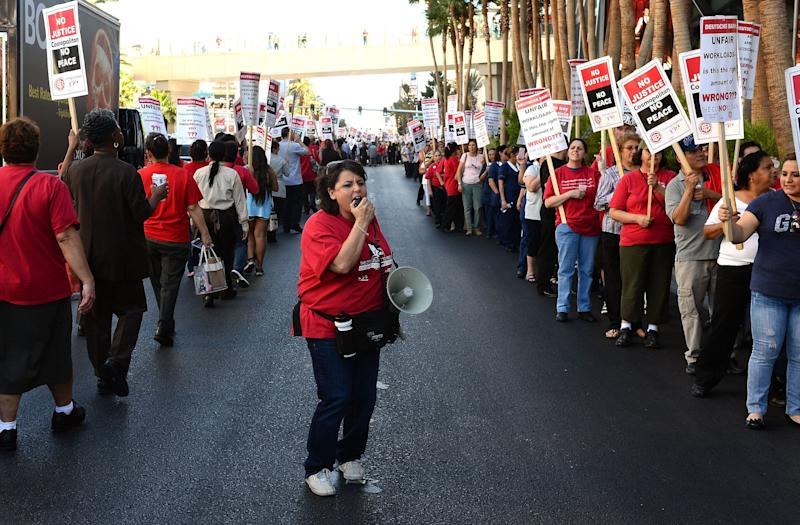 Culinary union members demonstrate outside The Cosmopolitan of Las Vegas in June 2013. The famously militant union is wary of jeopardizing its hard-fought gains. (Photo: Ethan Miller/Getty Images)
