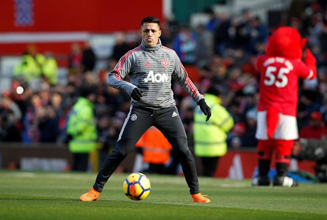 "Soccer Football - Premier League - Manchester United vs Chelsea - Old Trafford, Manchester, Britain - February 25, 2018 Manchester United's Alexis Sanchez warms up before the match REUTERS/Andrew Yates EDITORIAL USE ONLY. No use with unauthorized audio, video, data, fixture lists, club/league logos or ""live"" services. Online in-match use limited to 75 images, no video emulation. No use in betting, games or single club/league/player publications. Please contact your account representative for further details."