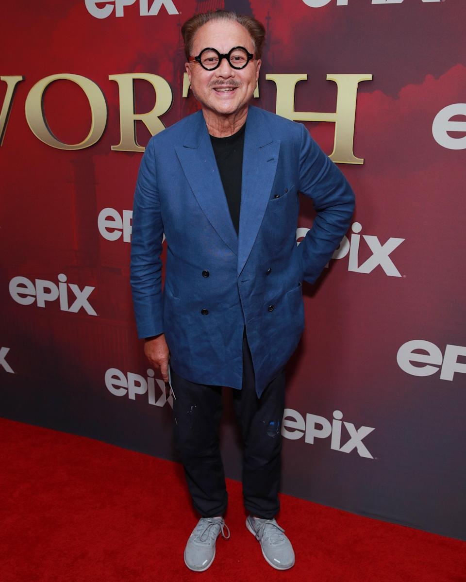 """<h1 class=""""title"""">July 25: Michael Chow</h1> <div class=""""caption""""> Michael Chow is the guy behind, yes, Mr. Chow—and also this righteous pair of glasses. </div> <cite class=""""credit"""">Getty Images</cite>"""