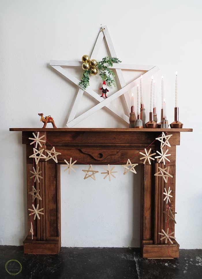 """<p>When fashioned into stars and snowflakes, craft sticks make for a surprisingly chic Christmas garland. </p><p><a href=""""https://www.ohohdeco.com/pop-sticks-garland/"""" rel=""""nofollow noopener"""" target=""""_blank"""" data-ylk=""""slk:Get the tutorial."""" class=""""link rapid-noclick-resp"""">Get the tutorial.</a></p><p><a class=""""link rapid-noclick-resp"""" href=""""https://www.amazon.com/Zeenom-Sticks-Removal-Applicator-Spatula/dp/B08D7WW2RT?tag=syn-yahoo-20&ascsubtag=%5Bartid%7C10072.g.37499128%5Bsrc%7Cyahoo-us"""" rel=""""nofollow noopener"""" target=""""_blank"""" data-ylk=""""slk:SHOP CRAFT STICKS"""">SHOP CRAFT STICKS</a></p>"""