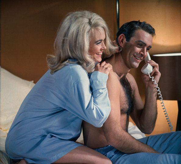 <p>James Bond (Sean Connery) and Jill Masterson (Shirley Eaton) share a laugh on the phone in Goldfinger, 1964.</p>