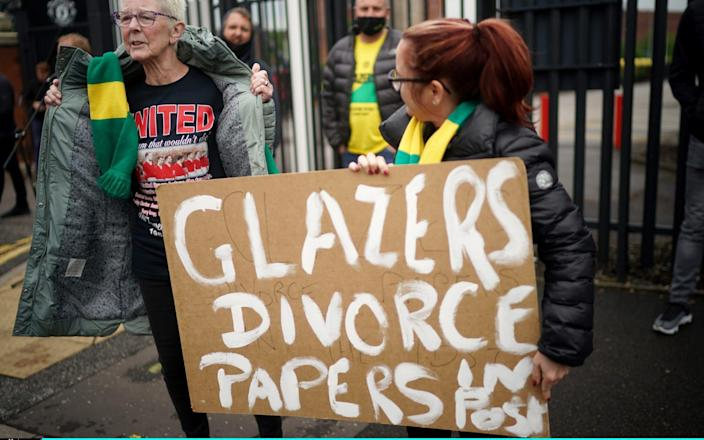 Protesters holding a placard reading 'Glazers Divorce Papers In Post' stand outside Old Trafford Stadium ahead of the Premier League match between Manchester United and Liverpoo - Getty Images