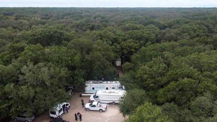 In this photo provided by North Port Police Department, law enforcement officials conduct a search of the vast Carlton Reserve in the Sarasota, Fla., area for Brian Laundrie on Saturday, Sept. 18, 2021.