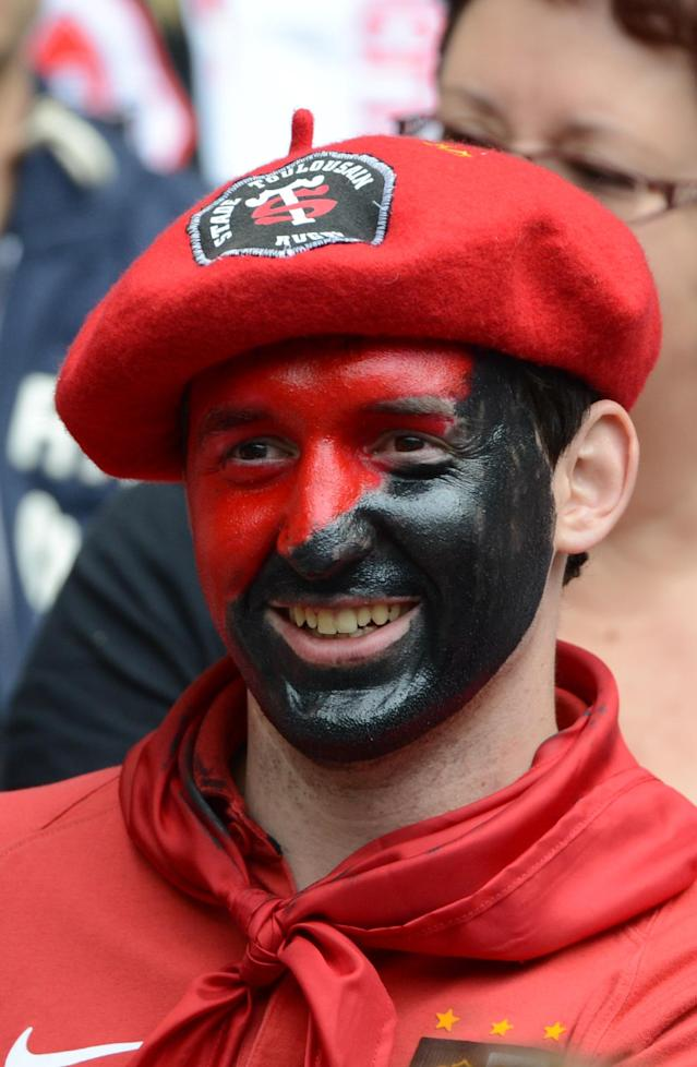 A supporter of Toulouse, with his face painted with the colours of his team, looks on before the French Top 14 rugby union final match Toulouse vs Toulon, on June 9, 2011 at the Stade de France in Saint-Denis, outside Paris. Toulouse won 18-12. AFP PHOTO / MARTIN BUREAUMARTIN BUREAU/AFP/GettyImages