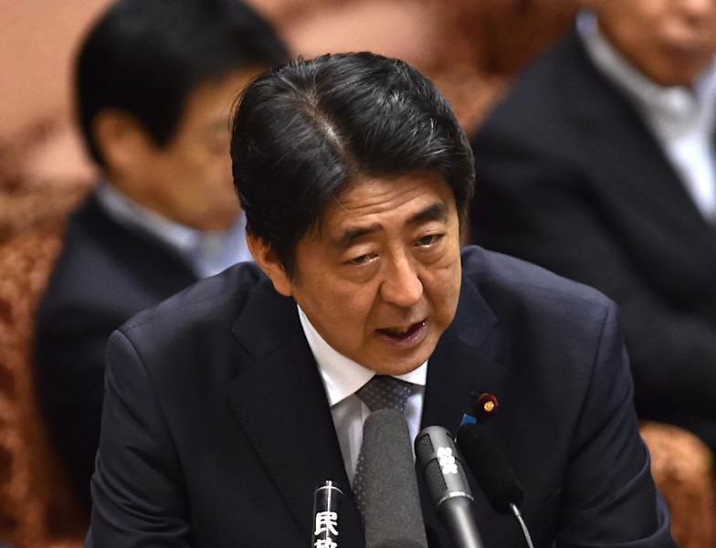 Japanese Prime Minister Shinzo Abe sees the security legislation as necessary to protect against threats from China and North Korea (AFP Photo/Yoshikazu Tsuno)