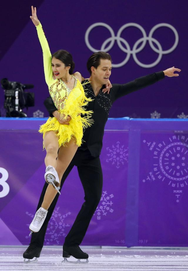 <p>Cortney Mansourova and Michal Ceska of Czech Republicperform. REUTERS/Phil Noble </p>