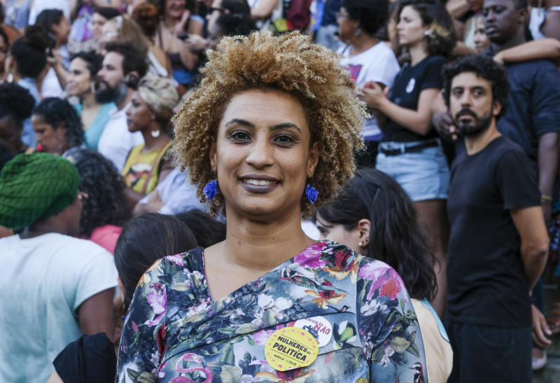 FILE - In this Jan. 9, 2018 file photo, Rio de Janeiro Councilwoman Marielle Franco smiles for a photo in Cinelandia square. Police in Brazil said on Tuesday, March 12, 2019, that they have arrested two suspects in the killing of Franco and her driver last year. (AP Photo/Ellis Rua, File)