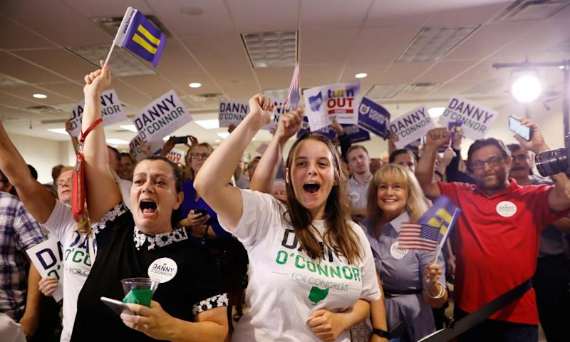 Supporters of Democratic candidate Danny O'Connor cheer in Westerville, Ohio Tuesday night. O'Connor lost, but the Democratic voter surge was significant.