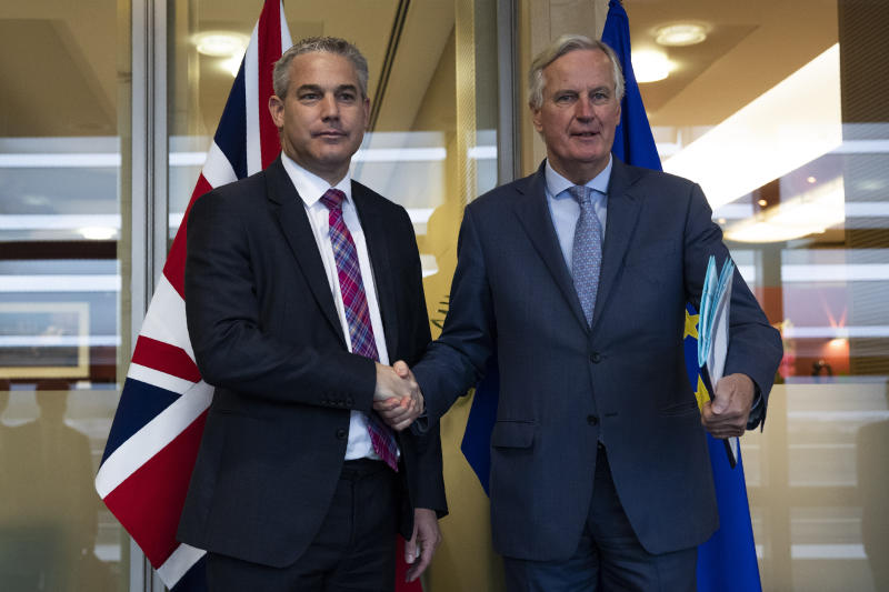 UK Brexit secretary Stephen Barclay, left, shakes hands with European Union chief Brexit negotiator Michel Barnier before their meeting at the European Commission headquarters in Brussels, Friday, Oct. 11, 2019