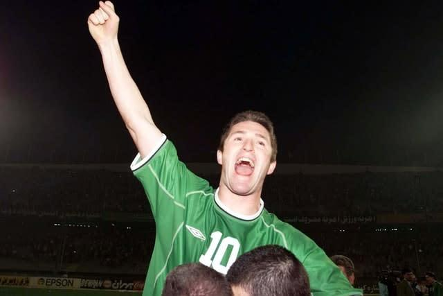 Robbie Keane celebrates in Tehran after after Ireland booked their place at the 2002 World Cup finals (Andrew Budd/PA)
