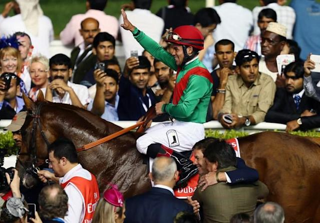 Jockey Joel Rosario jubilates after leading Animal Kingdom to win the 10 million US dollar Dubai World Cup, the world's richest race, at Meydan race track in Dubai March 30, 2013. The 2011 Kentucky Derby winner (11/2), trained by Australian Graham Motion and ridden by Joel Rosario, beat home English raider Red Cadeaux by two lengths while another English-trained runner Planteur was third. AFP PHOTO/MARWAN NAAMANI