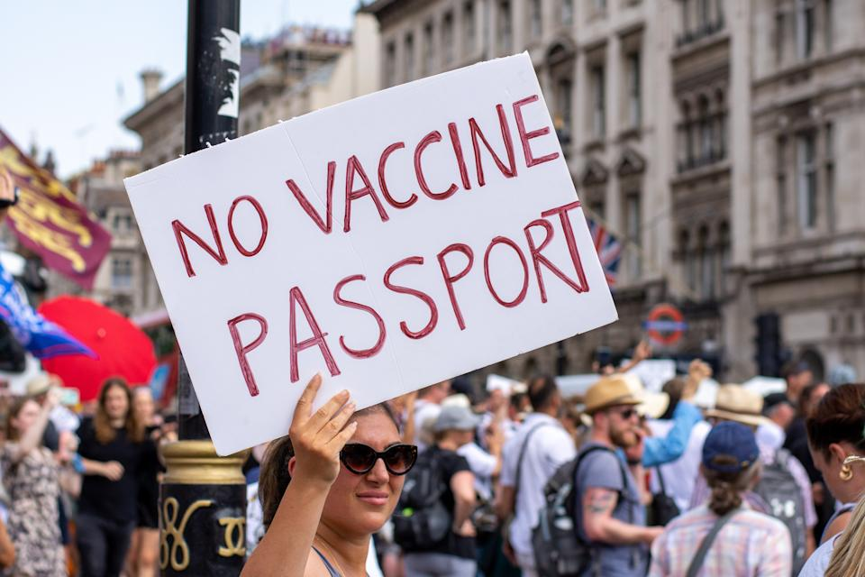 LONDON, UNITED KINGDOM - 2021/07/19: A protester holds a placard expressing her opinion during the demonstration. Thousands of people gathered near Parliament Square in a protest against health passports, protective masks, Covid-19 vaccines and lockdown restrictions. (Photo by Pietro Recchia/SOPA Images/LightRocket via Getty Images)