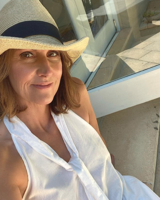 Natalie Barr in a white dress and sunhat