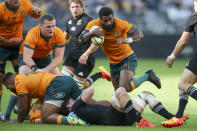 Australia's Marika Koroibete runs at the defense during the Rugby Championship game between the All Blacks and the Wallabies in Perth, Australia, Sunday, Sept. 5, 2021. (AP Photo/Gary Day)