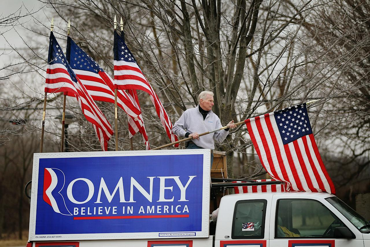 Jim Wilson, a supporter of Republican Presidential candidate Mitt Romney, decorates his truck outside a Tea Party event where Romney is scheduled to speak on February 23, 2012 in Milford, Michigan. Michigan residents will go to the polls on February 28 to vote their choice for the Republican presidential nominee.  (Photo by Scott Olson/Getty Images)