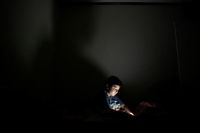 Thirteen effectively serves as the age of majority online under a two-decade old US law, and is the minimum set by Facebook, Twitter, Instagram and Snapchat -- all of which are massively popular among children (AFP/MARVIN RECINOS)