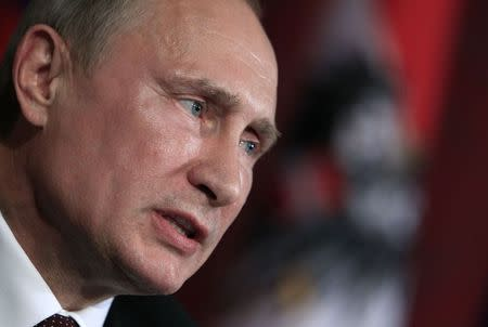 Russian President Vladimir Putin talks during a news conference in the presidential office in Vienna