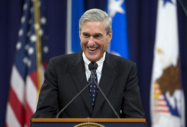 <p>Outgoing FBI Director Robert Mueller smiles as he speaks at the Justice Department in Washington, Thursday, Aug. 1, 2013, during his farewell ceremony. Mueller is stepping down in September after 12 years heading the agency. (Photo: Evan Vucci/AP) </p>