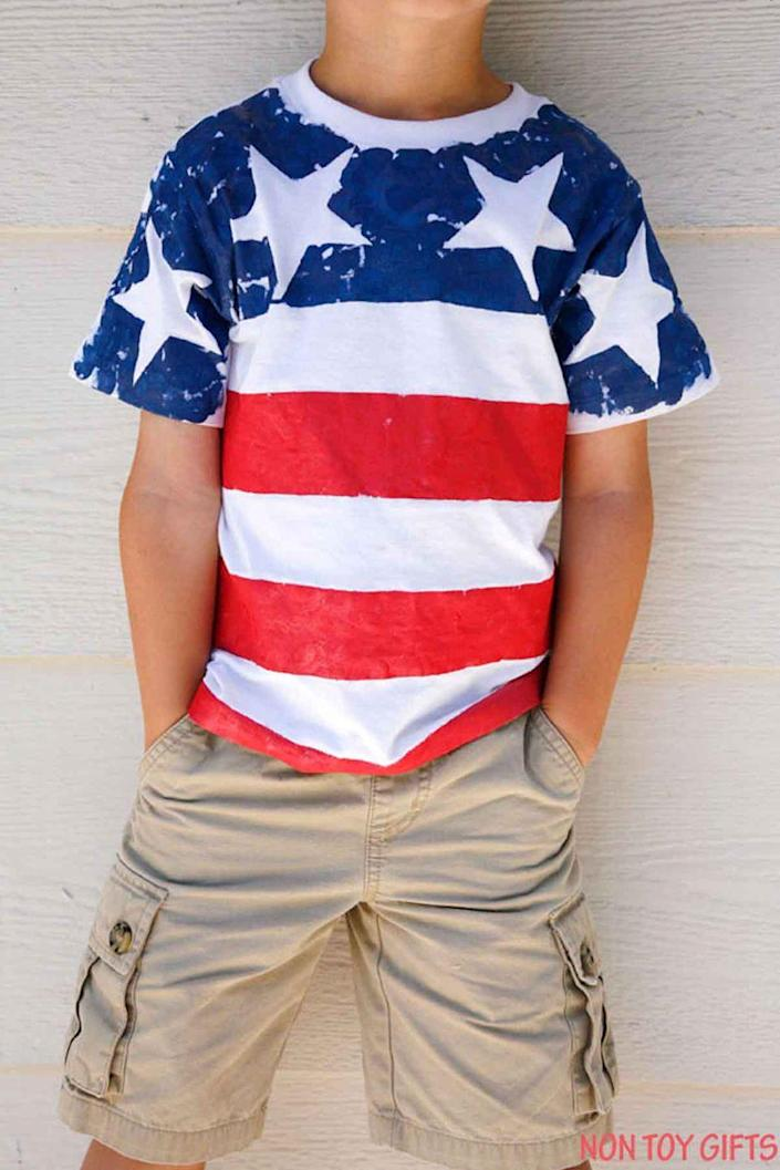 """<p>Help your kiddos make their own red, white, and blue T-shirts (and don't forget to make one for yourself!). </p><p><em><strong>Get the tutorial from <a href=""""http://nontoygifts.com/diy-flag-t-shirts-for-kids/"""" rel=""""nofollow noopener"""" target=""""_blank"""" data-ylk=""""slk:Non-Toy Gifts"""" class=""""link rapid-noclick-resp"""">Non-Toy Gifts</a>. </strong></em> </p>"""
