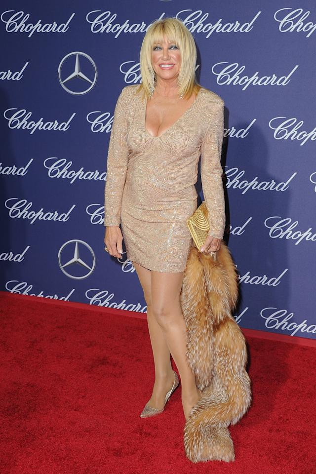 <p>The 70-year-old turned heads in a gold minidress with a plunging neckline. She carried a fur coat for some extra fab. (Photo: Getty Images) </p>