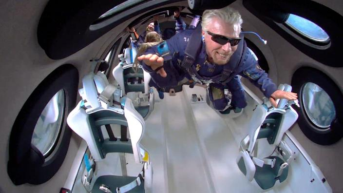 Richard Branson in space aboard a Virgin Galactic rocket plane.  - 254301490057f4973f7d9e89f2fab152 - Watch live as Jeff Bezos launches into space on Blue Origin's first passenger flight