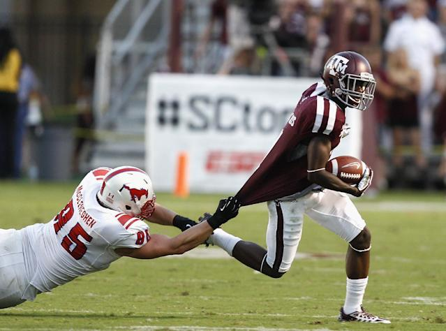 Texas A&M's De'Vante Harris (1) attempts to get away from SMU defensive lineman Andrew McCleneghen (95) as he runs with the ball during the second quarter of an NCAA college football game Saturday, Sept. 21, 2013, in College Station, Texas. (AP Photo/Bob Levey)