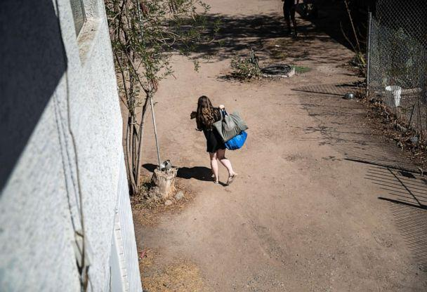 PHOTO: A child carries a pet from her apartment after her family was evicted for non-payment of rent on Sept. 30, 2020, in Phoenix, Arizona. (John Moore/Getty Images)