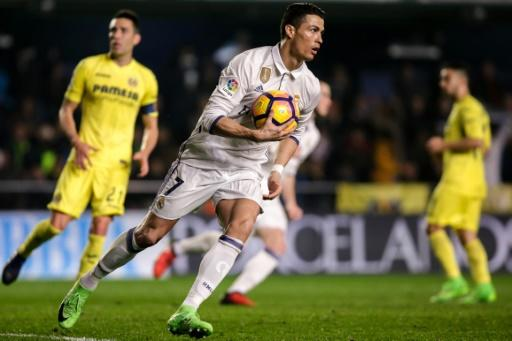 Real Madrid's forward Cristiano Ronaldo runs with the ball after scoring a goal on February 26, 2017