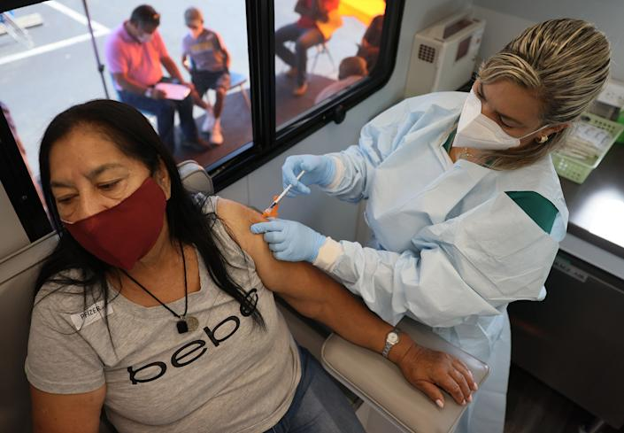 Ilcira Roca receives a Pfizer-BioNTech COVID-19 vaccine from Yelany Lima, a Registered Nurse, at the UHealth's pediatric mobile clinic on May 17, 2021 in Miami, Florida. (Joe Raedle/Getty Images)