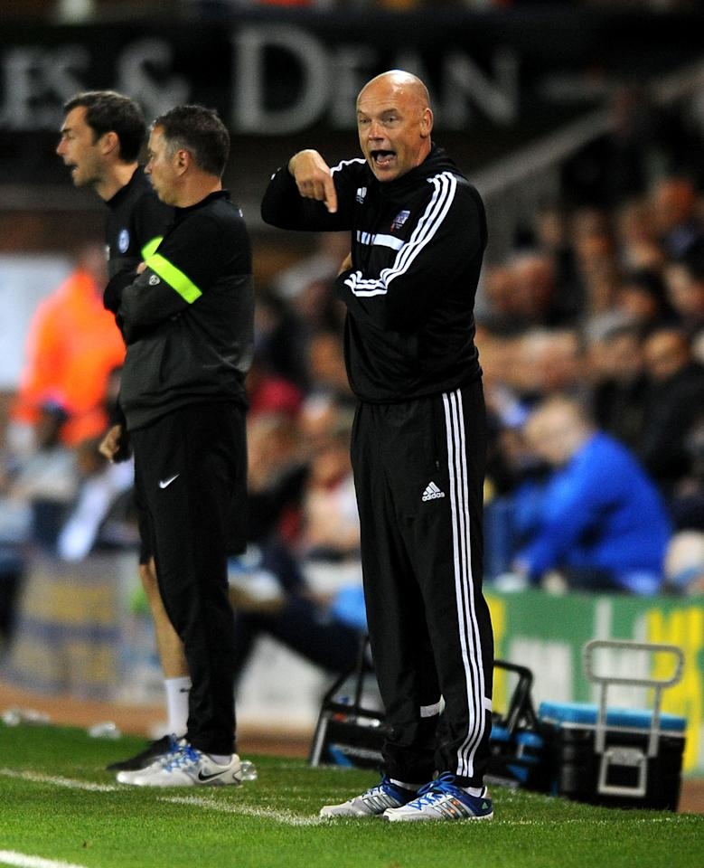 Brentford manage Uwe Rosler gestures during the Johnstone's Paint Trophy match at London Road, Peterborough.