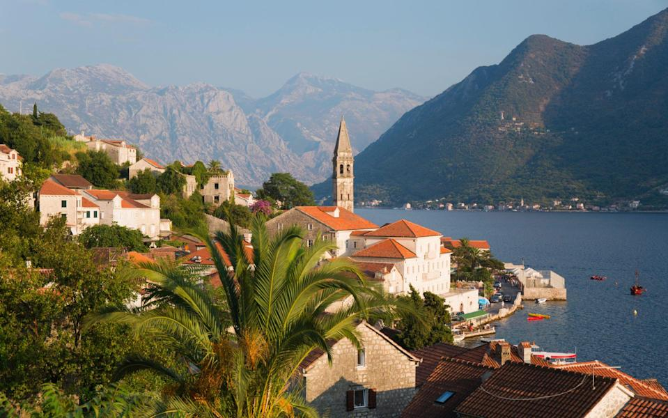 Kotor sits between mountains and a romantic sweep of the bay - DAVID C TOMLINSON