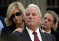 FILE - In this Jan. 8, 2001 file photo, former Louisiana Gov. Edwin Edwards, standing with his wife, Candy, left, and daughter, Anna Edwards, listens to a question from the media, on the steps of the federal courthouse in Baton Rouge, La. Edwards, the high-living four-term governor whose three-decade dominance of Louisiana politics was all but overshadowed by scandal and an eight-year federal prison stretch, died Monday, July 12, 2021, of respiratory problems. He was 93. (AP Photo/Bill Haber, File)