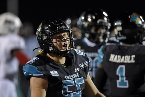 Coastal Carolina's CJ Schrimpf (55) reacts after making a play during the first half of an NCAA college football game against South Alabama, Saturday, Nov. 7, 2020, in Conway, S.C. (AP Photo/Richard Shiro)