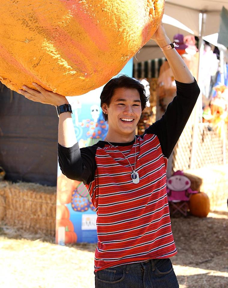 """""""Twilight"""" star Boo Boo Stewart picked out the biggest pumpkin he could find! (10/23/2011)"""