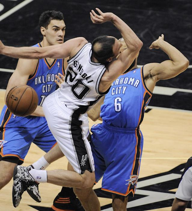San Antonio Spurs guard Manu Ginobili (20) is pressured by Oklahoma City Thunder's Derek Fisher (6) and Steven Adams during the first half of Game 5 of the NBA basketball Western Conference finals, Thursday, May 29, 2014, in San Antonio. (AP Photo/Darren Abate)