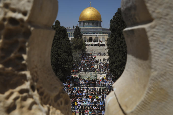 Palestinian worshipers pray during the first Friday of the holy month of Ramadan at the Al Aqsa Mosque compound in Jerusalem's old city, Friday, April. 16, 2021. (AP Photo/Mahmoud Illean)