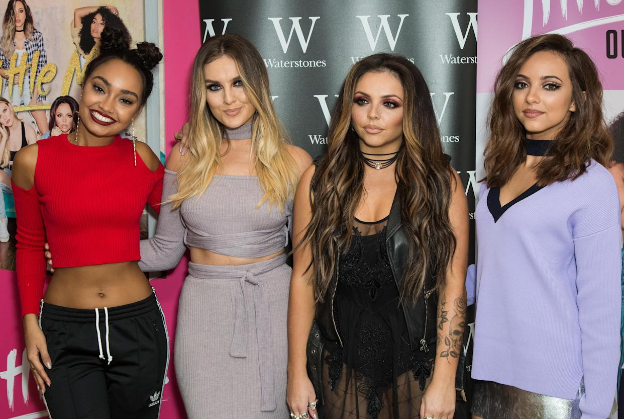 Band members of music group Little Mix, from left, Leigh-Anne Pinnock, Perrie Edwards, Jesy Nelson and Jade Thirlwall pose for photographers during a photo call before signing copies of their book 'Our World', in London, Saturday, Oct. 22, 2016. (Photo by Vianney Le Caer/Invision/AP)