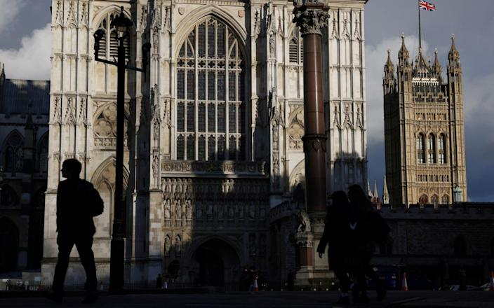A person walks past Westminster Abbey - Henry Nicholls/Reuters